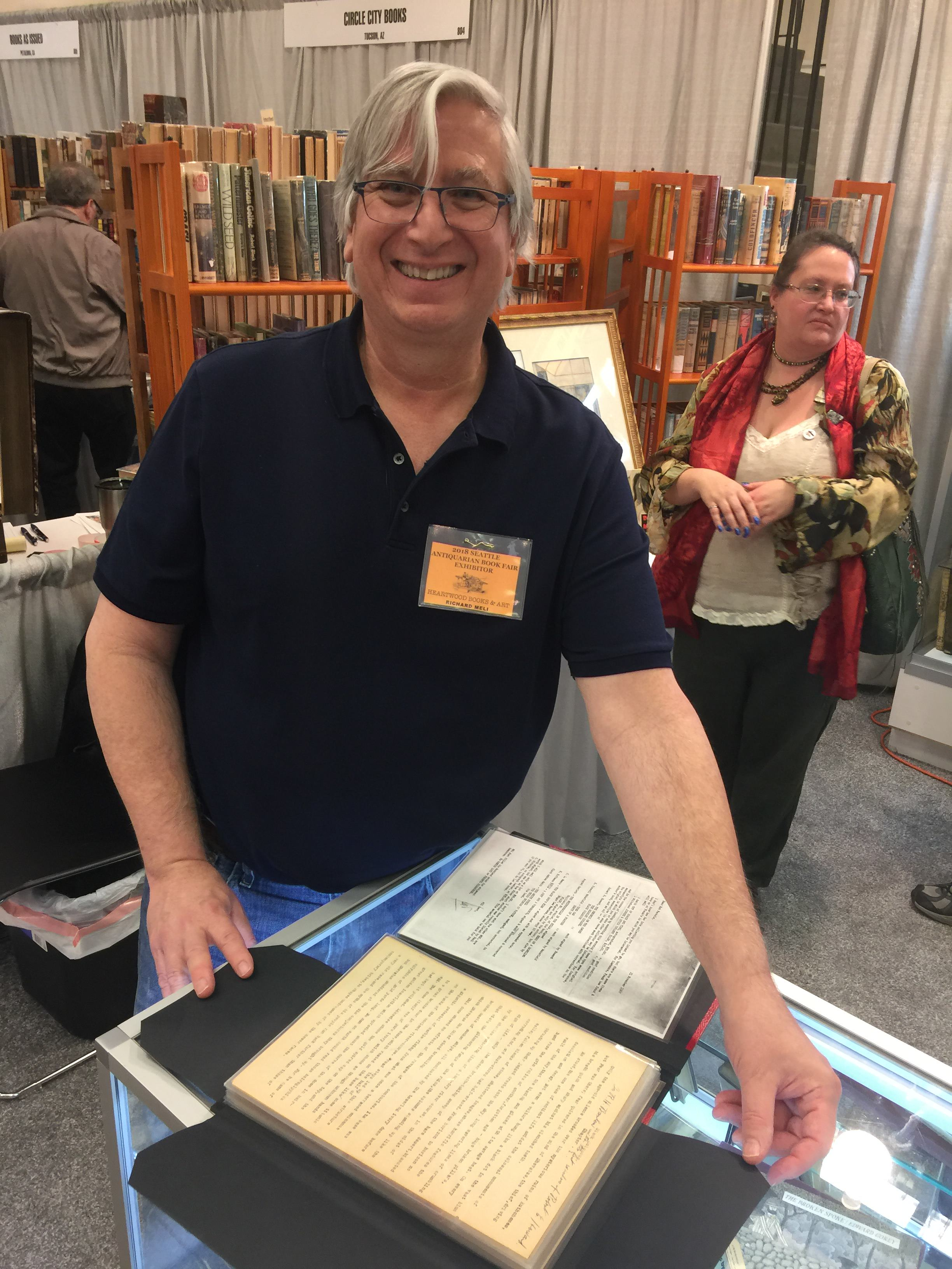 Dr. Richard Meli of Heartwood Books showing me a treasure - see photos below
